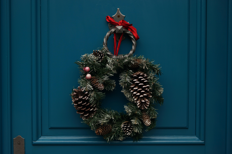 Christmas wreath hung on door knocker