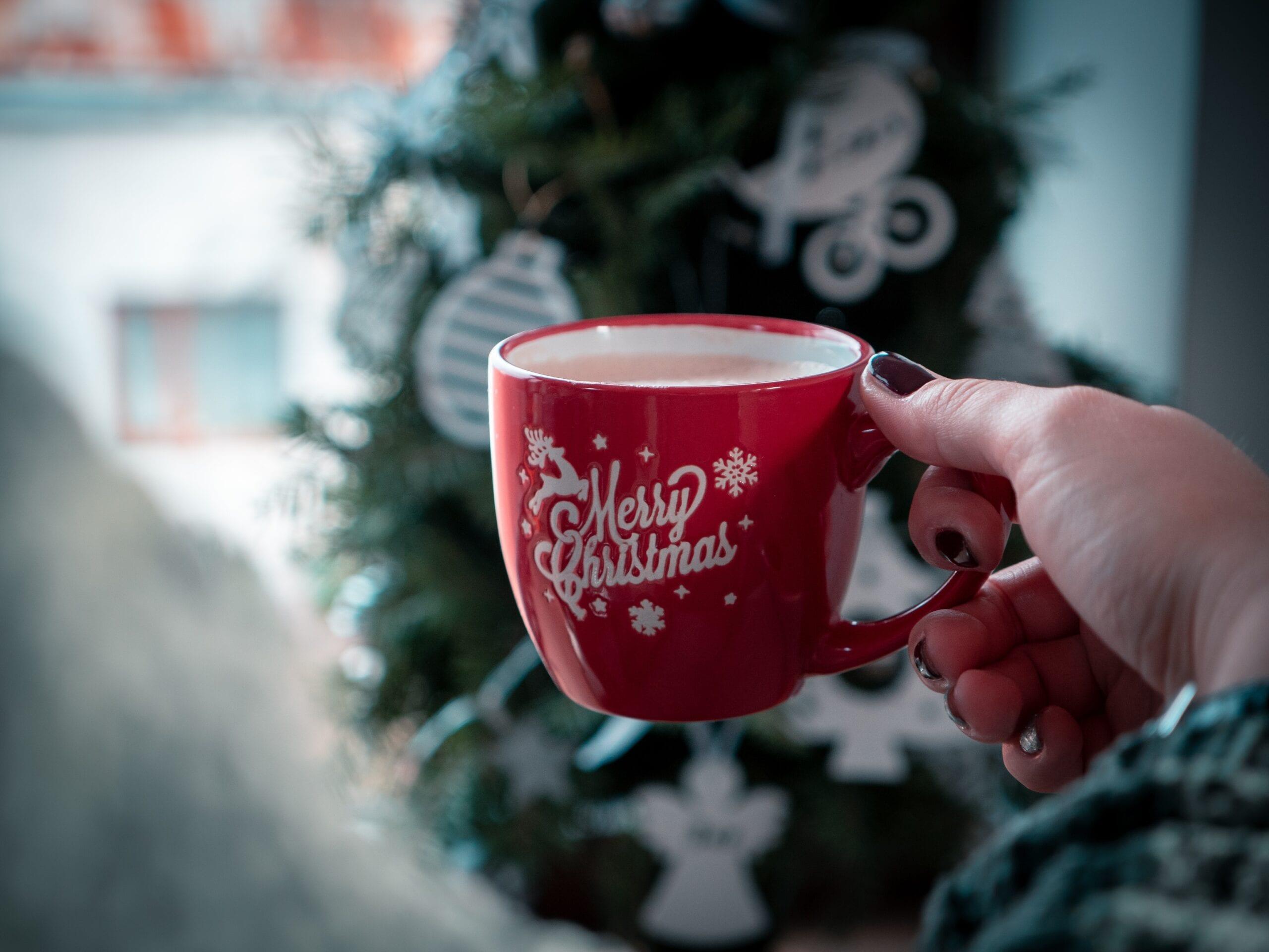 Woman drinking from Merry Christmas mug