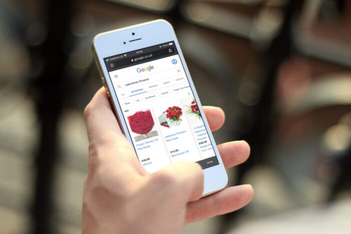 Man shopping for Valentine's flowers on iPhone
